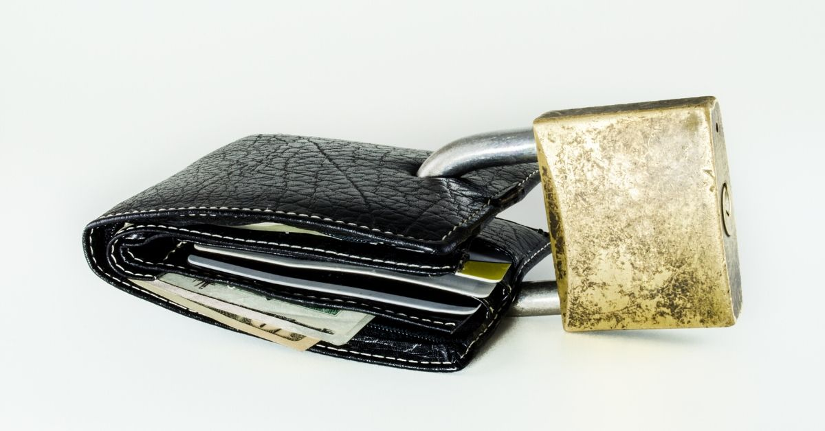 Simple Steps to Protect Your Identity - picture of lock going through a wallet
