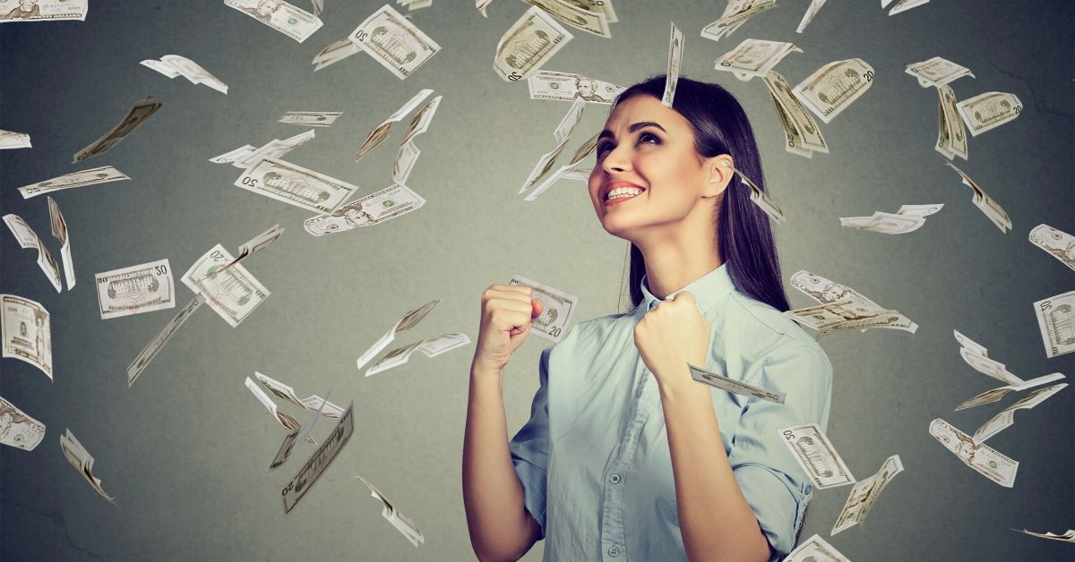 Balance Transfer Card Saved Me 80 Years of Payments - picture of young woman celebrating in money rain