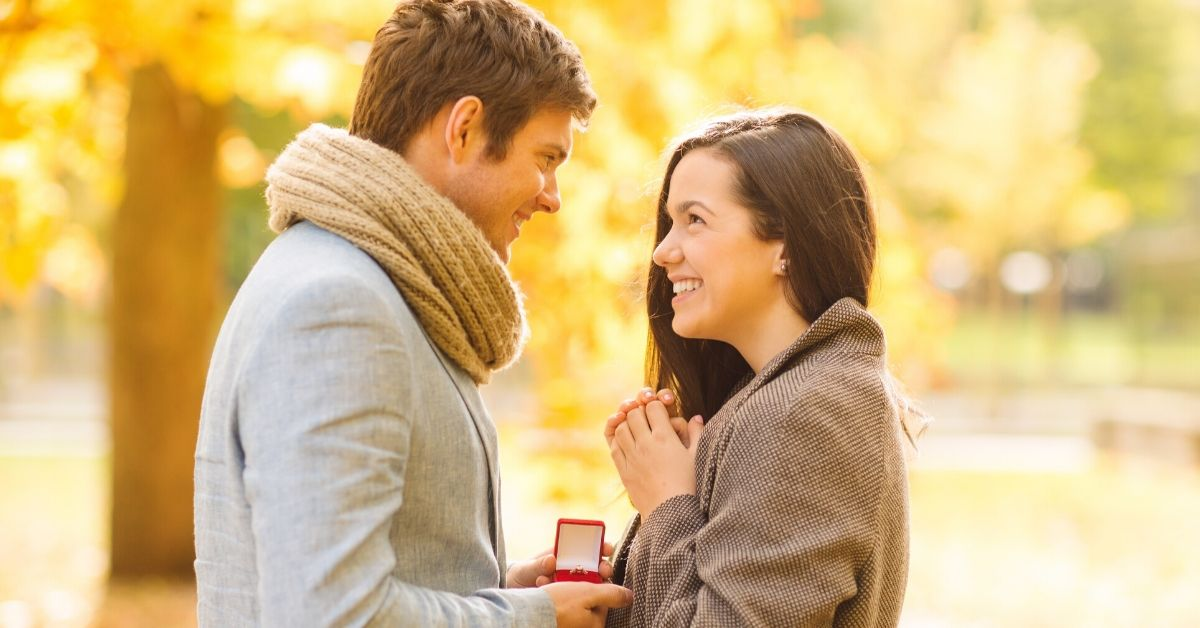 Why I'll Never Upgrade My Engagement Ring - picture of man holding out red box to woman in park