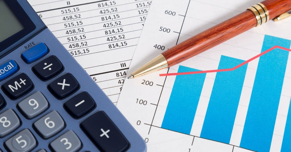 June 2016 Income Report - picture of calculator, pen, and business reports