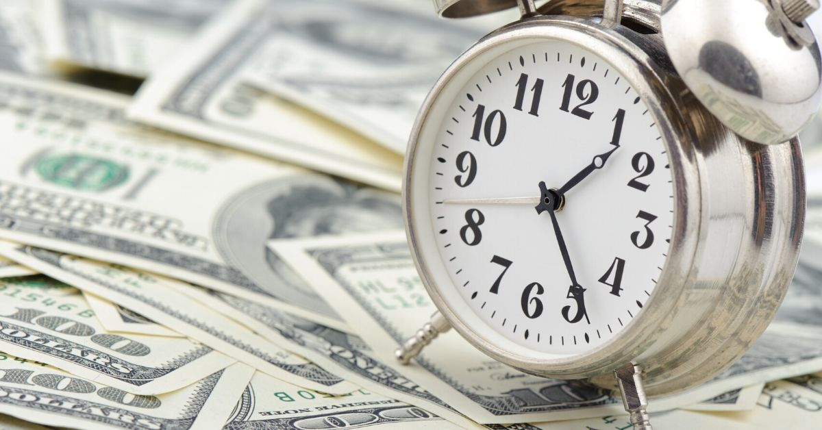 Money is Time for the Future - picture of alarm clock sitting on cash