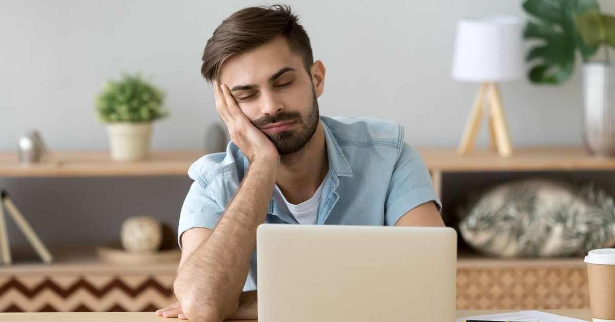 Savings Fatigue - picture of man asleep at his desk with laptop in front of him