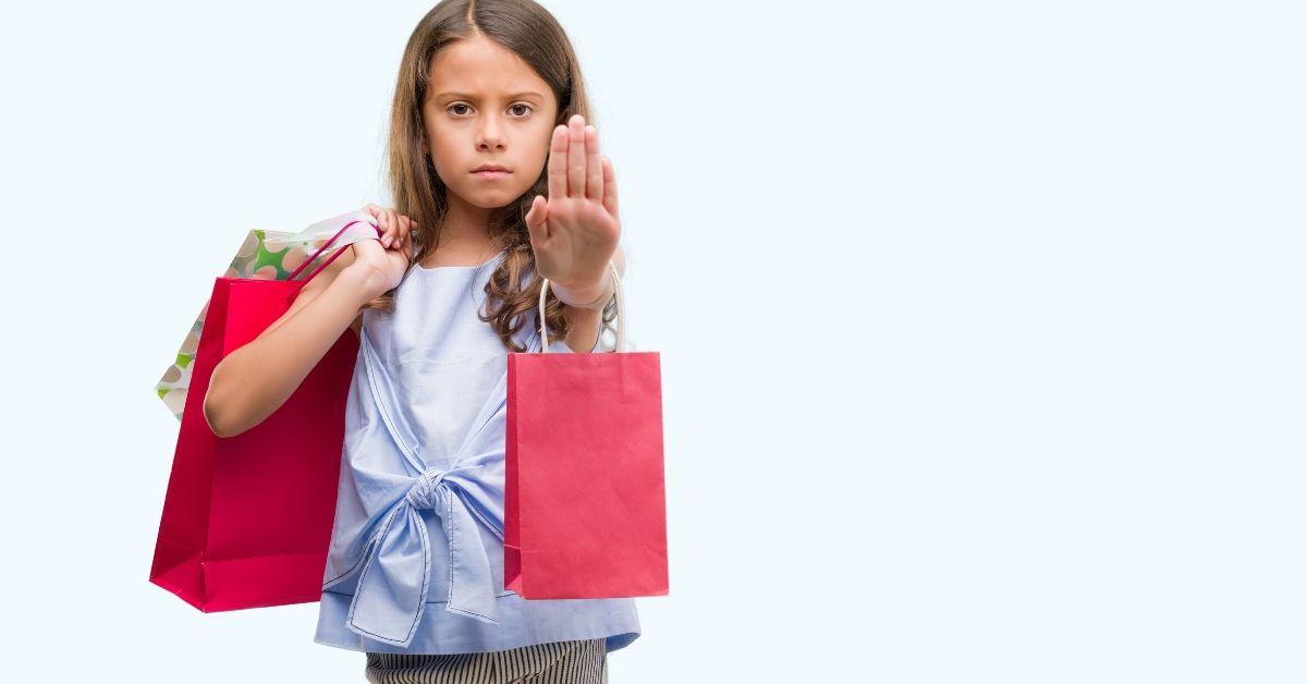 Why I'm Skipping Black Friday - picture of young girl with shopping bags and hand held out