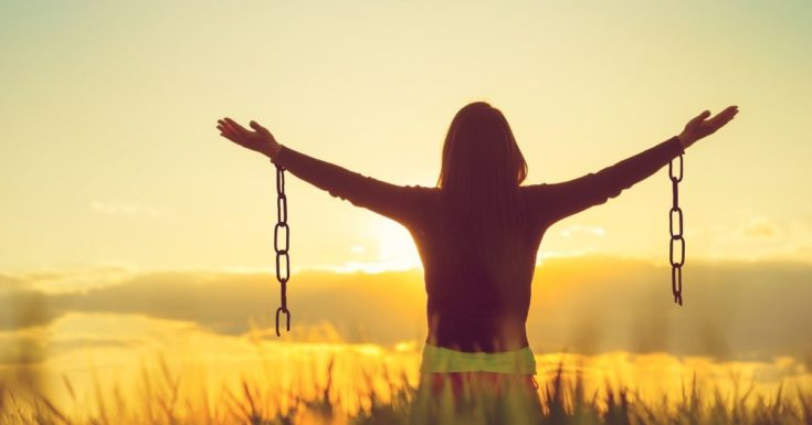 Truths for Destroying Debt - picture of woman in field with broken chains