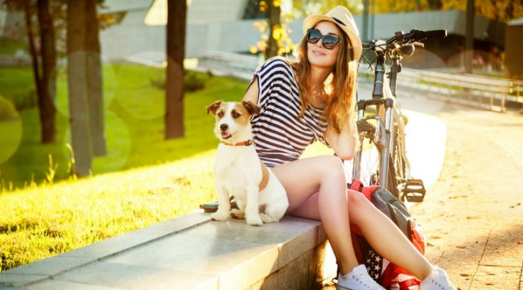 image of smiling woman with dog outside