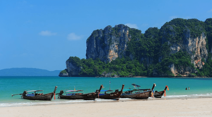 krabi, thailand - image of boats on the beach