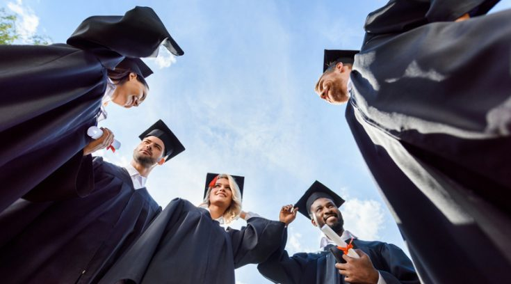 image of recent graduates standing in a circle