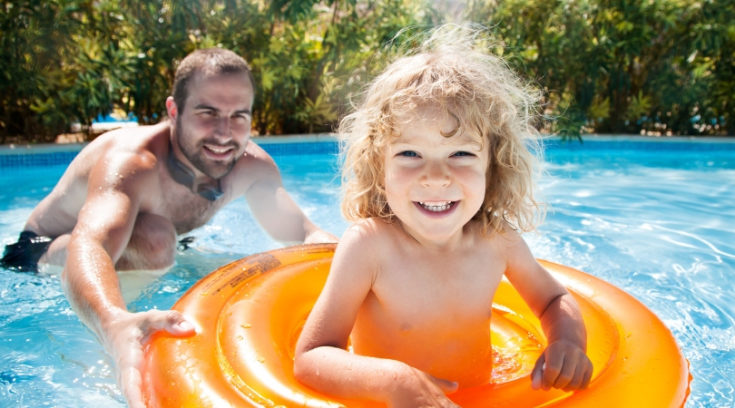 many playing in pool with child - Searching for the best travel insurance companies? Compare our favorite international medical, trip insurance, and travelers insurance programs here!