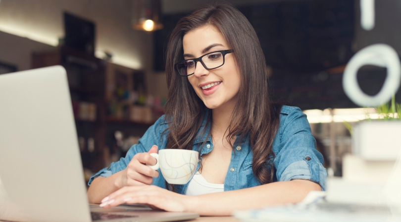 personal capital vs. quicken - photo of woman drinking coffee on computer