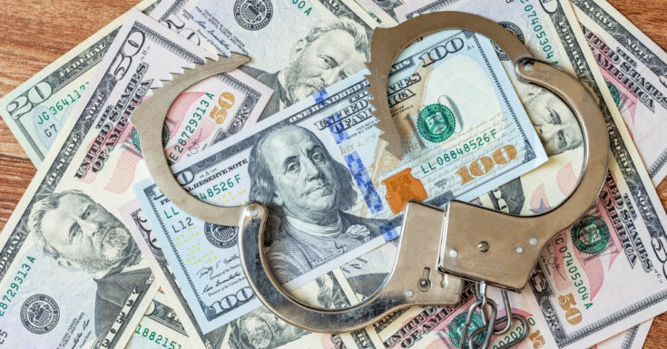 Wealthfront Review - photo of unlocked handcuffs on top of cash