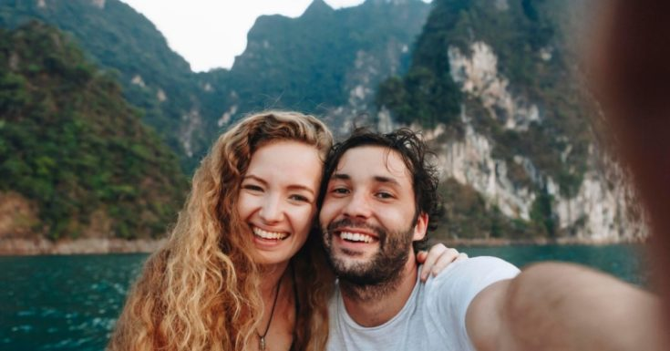 Best short-term investments - picture of couple in mountainous lagoon