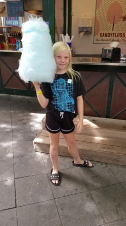 Photo of girl with giant cotton candy stick