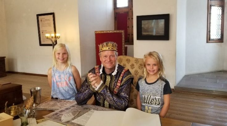 Photo of actor playing a king and two girls