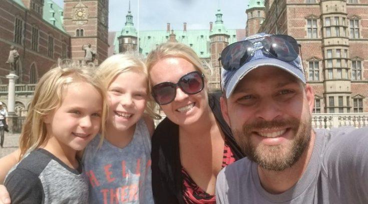 Family selfie in front of Frederiksborg Castle, Denmark