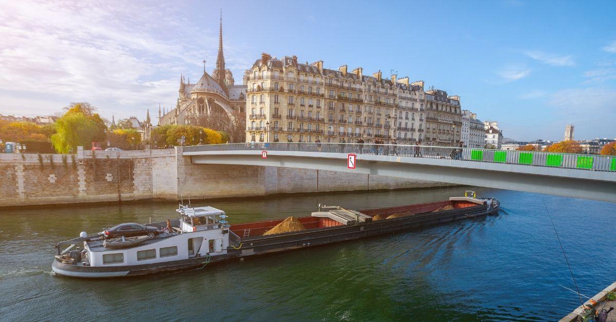 Paris Pass vs Go Paris Explorer Pass - picture of Seine River cruise boat in front of Notre Dame