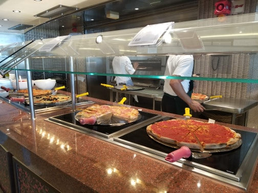 photo of pizzas on buffet