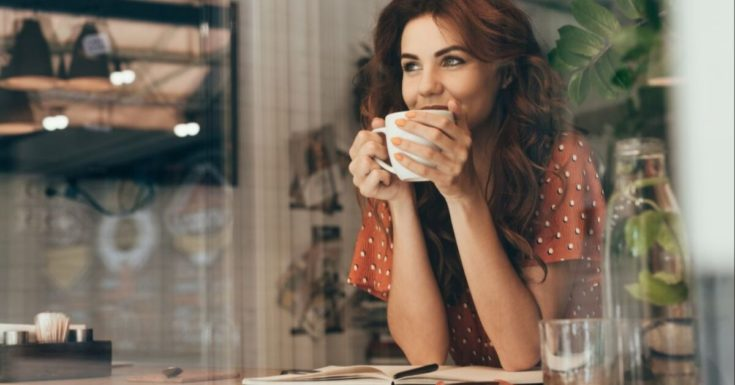 Capital One Quicksilver Cash Rewards Credit Card Review - picture of smiling woman drinking coffee
