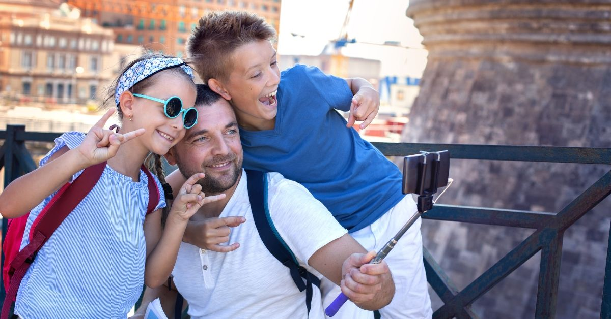 Chase Sapphire Preferred vs Reserve Cards - picture of dad taking selfie with kids in foreign country