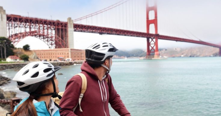 picture of bicyclists looking at Golden Gate Bridge