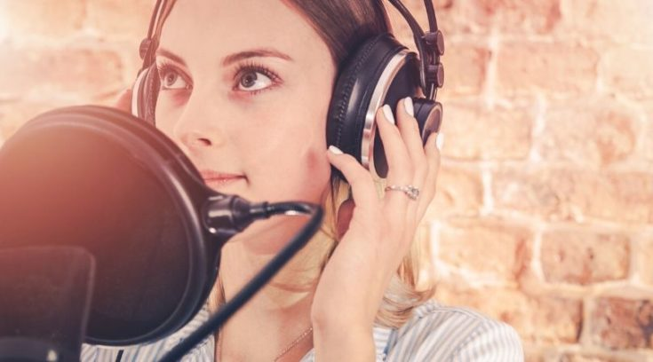 image of woman at microphone