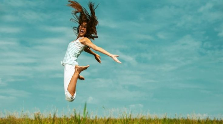 best cash back credit cards - image of woman jumping for joy