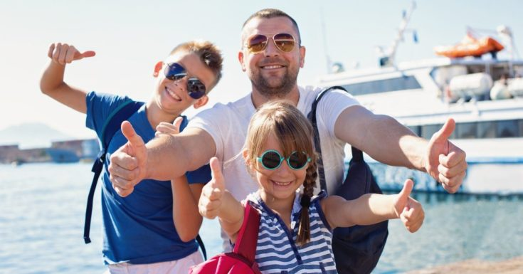 Capital One Venture Card Review - picture of father and two kids with thumbs up in front of cruise ship