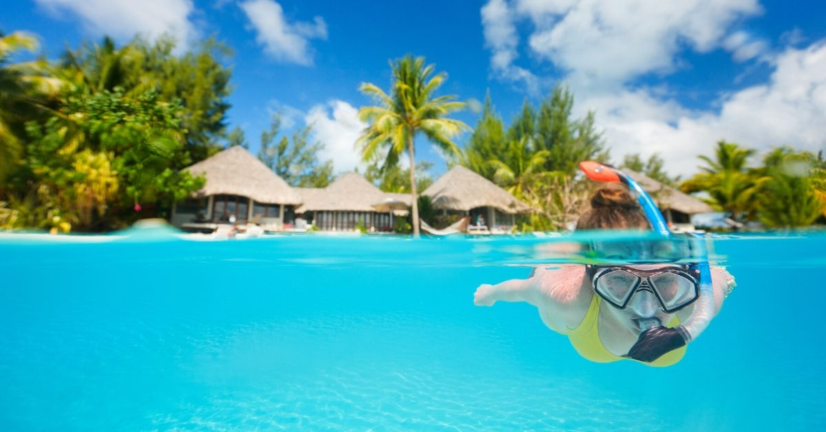 Amex Platinum Benefits - picture of woman snorkeling in exotic location