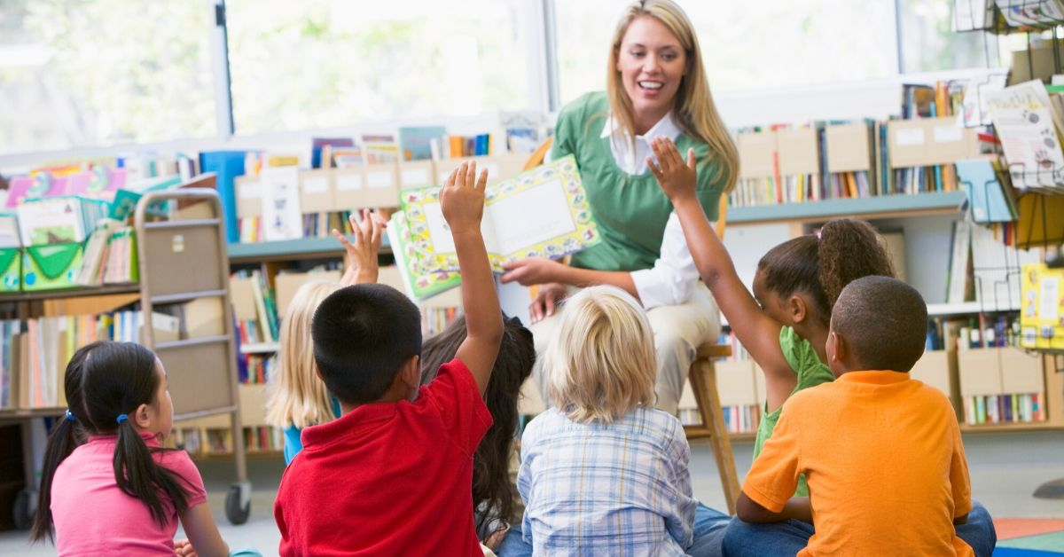 TEACH Grant Review - picture of female teacher reading to young kids