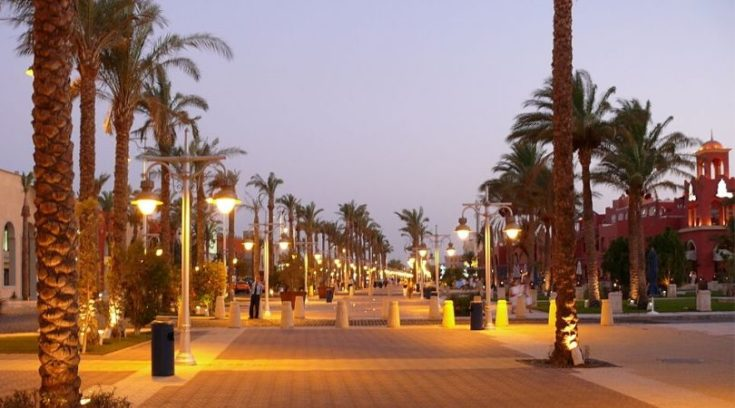 image of sidewalk with palm trees in Hurghada, Egypt