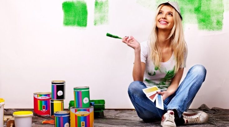 image of woman painting and smiling