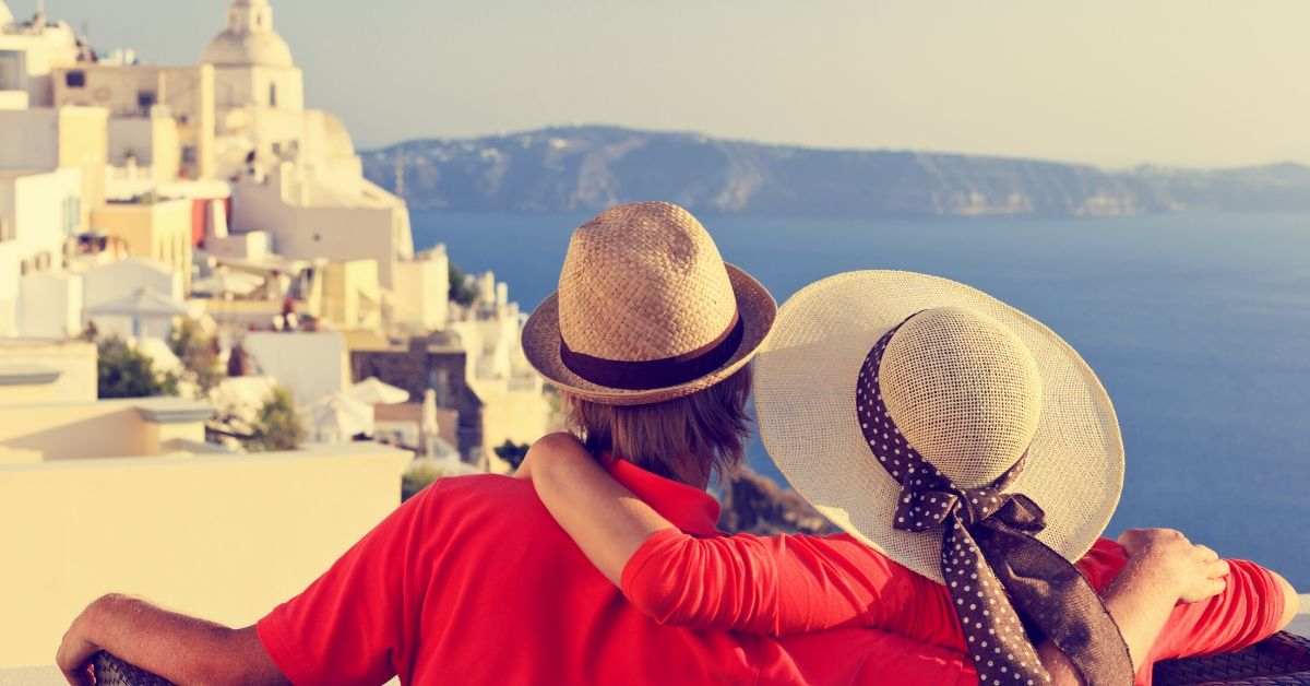 Gold Delta SkyMiles Card Review - picture of couple overlooking Greek city