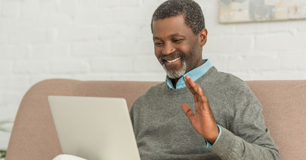 Liberty Tax Service Review - picture of African American man smiling at laptop