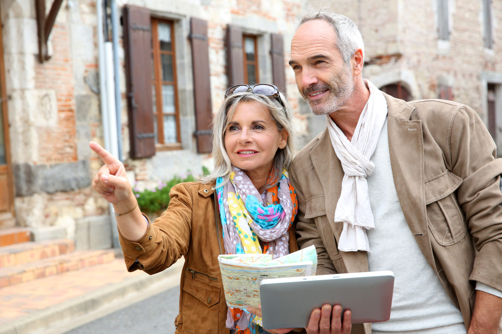 Amex Travel Insurance Review - senior couple with map in Europe