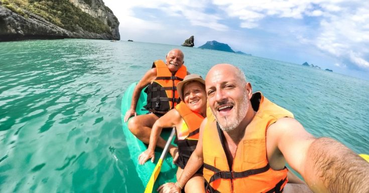 Amex Travel Insurance Review - picture of three seniors in kayak taking selfie