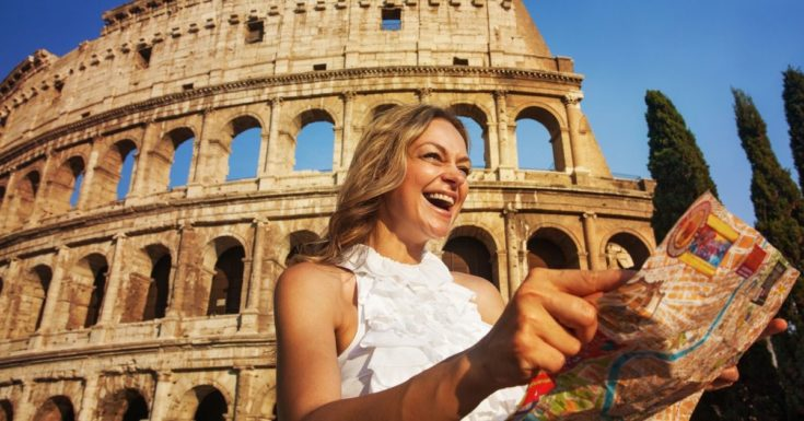 ETIAS Review_woman laughing at map in front of Colosseum