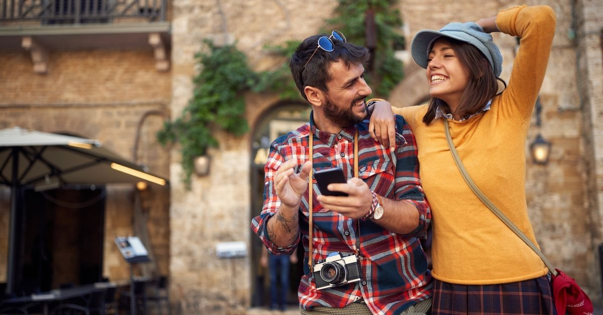 Capital One Venture Card Benefits - picture of young couple laughing on European street
