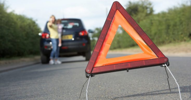 What is an Emergency Fund - picture of hazard flag in road with broken down car in background