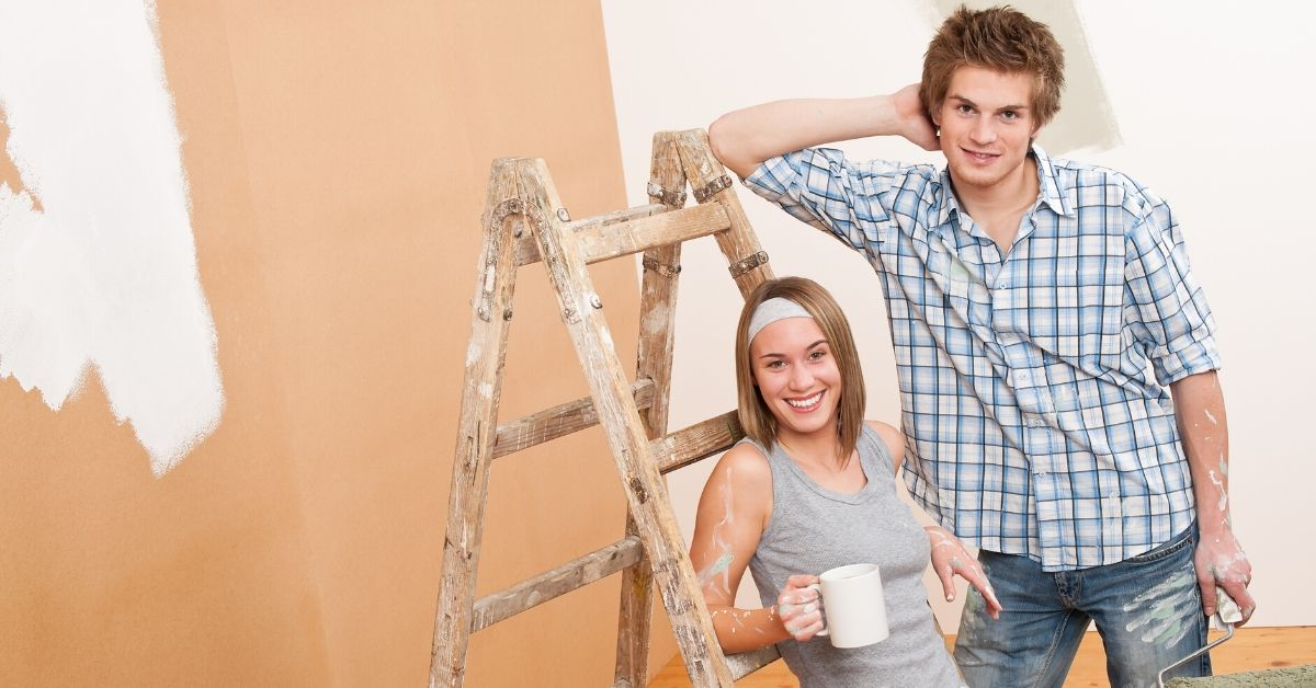 What is a Money Market Account - picture of young couple painting new house