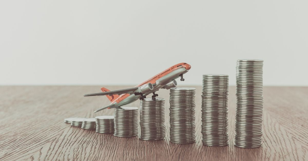 CIT Bank Money Market Review - picture of toy plane sitting on increasing stack of coins
