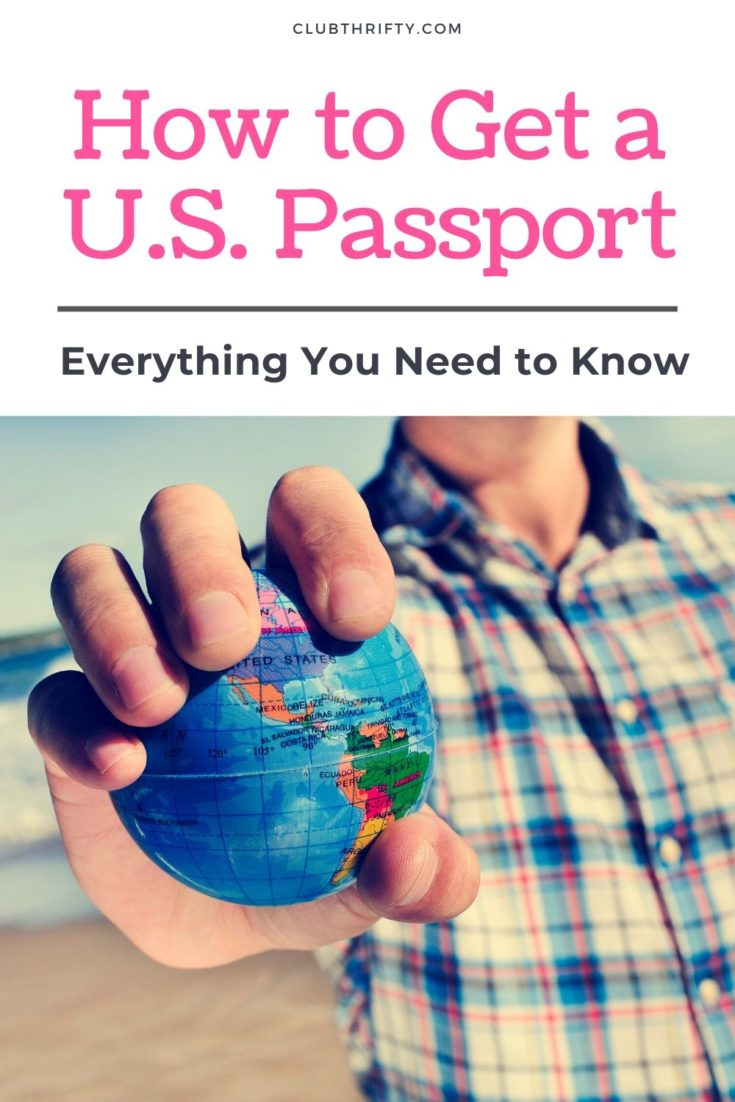 How to Get a U.S. Passport Pin - closeup of man holding out a globe in his hand at the beach