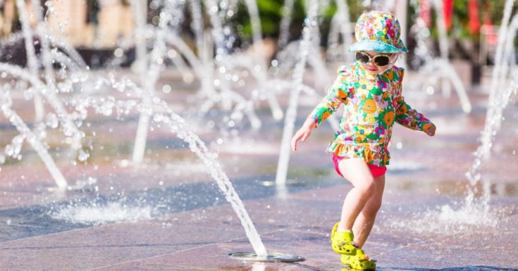 Tampa Bay CityPASS Review - picture of toddler girl running through splash pad