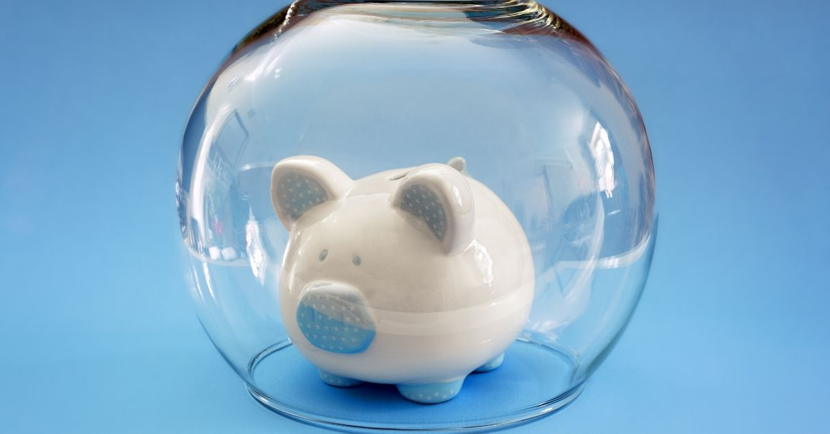 What is the NCUA - picture of white piggy bank inside upside down fish bowl