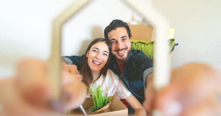 Best Budgeting Apps - picture of couple seen through frame of a house they are holding up