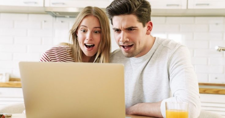 What is a Zero-Based Budget - picture of couple looking at laptop screen with surprised look on their faces