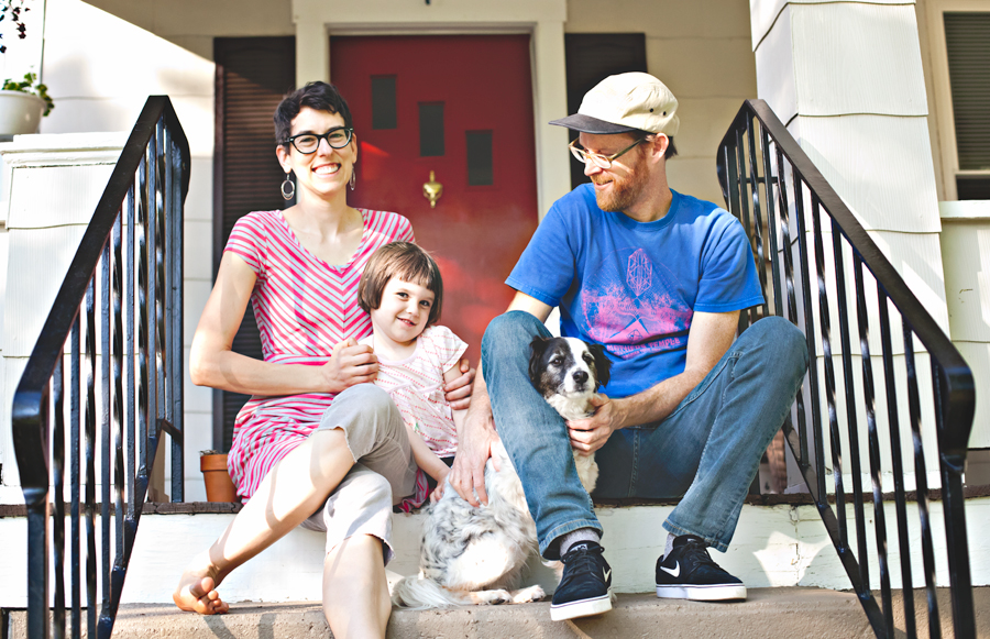 Joe with his amazing wife Sara, daughter Frances, and Scooter-the dog.