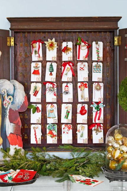 Hung inside an old hotel key cabinet, numbered gift tags adorned with tiny ornaments make for a homespun Christmas countdown. What you'll need: Gift tags ($7, amazon.com); Tiny ornaments ($20, amazon.com)