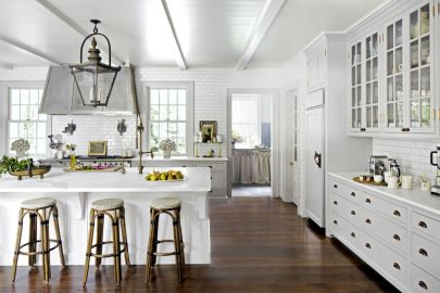 """If you choose a light paint for walls or cabinetry, select a dark floor stain to up the cozy factor of the room. Mixone-half Ebony and one-half Jacobean from Minwax. Bonus idea: The addition of furniture-like """"feet"""" gives cabinetry a softer, more custom feel."""