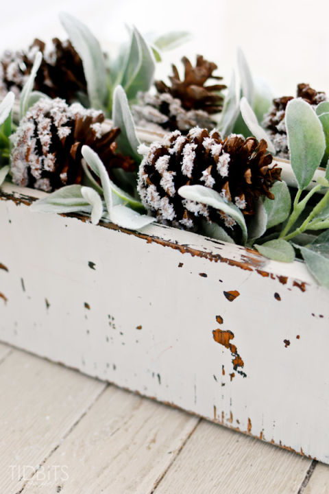 If you're lucky to have a tree with pine cones in your backyard, collect about a dozen for this simple craft. Get the tutorial at Ella Claire. What you'll need: sparkling snow ($4, amazon.com); Mod Podge ($6, amazon.com)