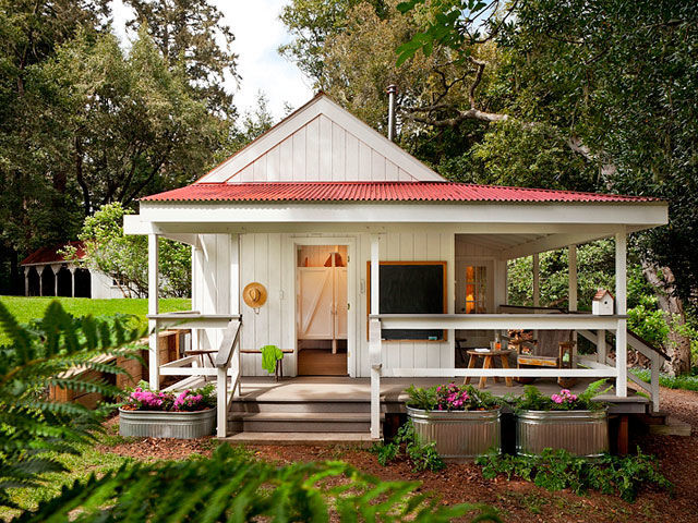 Tiny Houses Farmhouse with Wraparound Porch Pink Flowers Barn Doors Red Roof