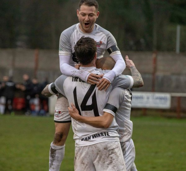 Aiden Lewis celebrates with Luke Gullick and Gavin Beddard
